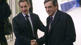 L'ancien président Nicolas Sarkozy et l'ancien Premier ministreFrançois Fillon au siège de l'UMP (ex-Les Républicains), à Paris, le 2 décembre 2014. (LIONEL BONAVENTURE / AFP)