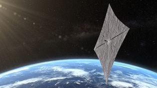 La représentation d'une voile solaire de l'organisation américaine Planetary Society, avec le concept de LightSail 2,au-dessus de la Terre. (JOSH SPRADLING / THE PLANETARY SOCIETY / AFP)
