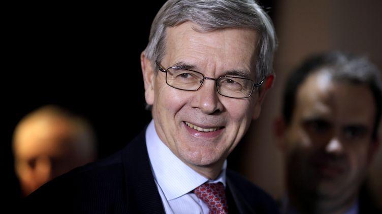 Le président du directoire de PSA, Philippe Varin, le 25 novembre 2013 à Paris. (KENZO TRIBOUILLARD / AFP)