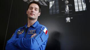 Thomas Pesquet, le prochain Français à voyager dans l'espace, pose à Paris, le 17 mars 2014. (FRANÇOIS GUILLOT / AFP)