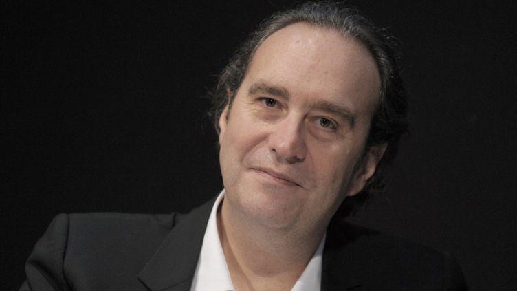 Le patron d'Iliad (Free), Xavier Niel, le 10 mars 2014 à Paris. (ERIC PIERMONT / AFP)