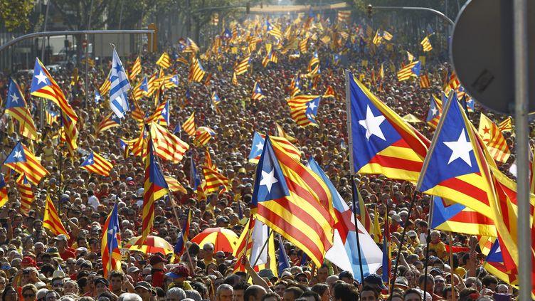 Des manifestants catalans dans les rues de Barcelone (Espagne), le 11 septembre 2014. (QUIQUE GARCIA / AFP)