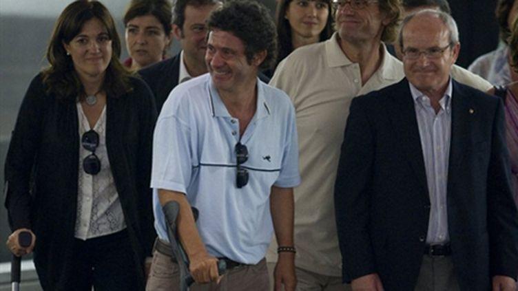 Roque Pascual et Albert Vilalta, volontaires de l'ONG catalane Accio Solidaria, à leur arrivée à Barcelone le 24/08/10 (AFP. J.Lago)