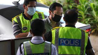 Chan Eu Boon, le fondateur de Sugar Book, arrive dans un tribunal près de Kuala Lumpur (Malaisie), le 24 février 2021 (FAHMI DAUD / AFP)