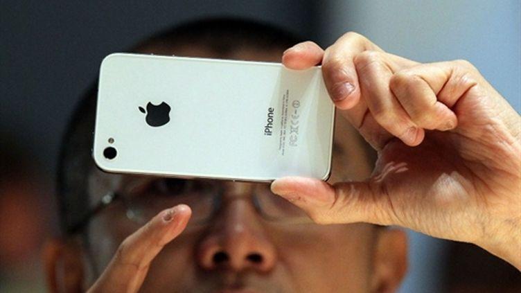 Le stockage de données géolocalisées de l'iPhone et de l'iPad serait dû à des bugs du système d'exploitation (AFP Justin Sullivan)