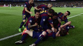 Les joueurs du Barça fêtent leur victoire contre le Bayern en Ligue des champions, le 6 mai 2015. (PIERRE-PHILIPPE MARCOU / AFP)