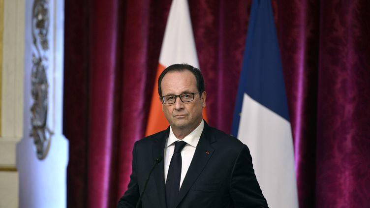 Le président de la République François Hollande le 19 septembre 2014 à Paris. (FRED DUFOUR / AFP)