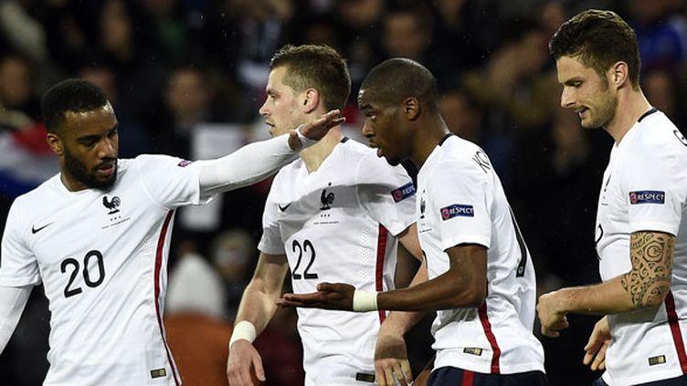 Les joueurs français Alexandre Lacazette, Morgan Schneiderlin, Geoffrey Kondogbia et Olivier Giroud