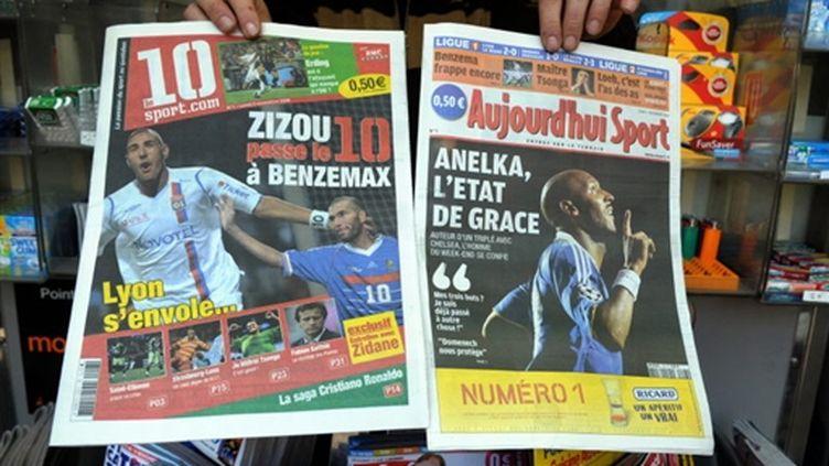 Aujourd'hui-Sport et son concurrence Le 10 Sport (© AFP PHOTO ERIC PIERMONT)