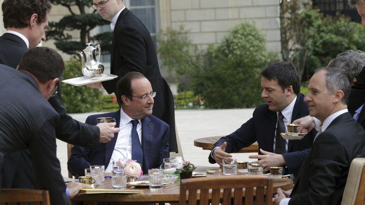 François Hollande reçoit au palais de l'Elysée le président du Conseil italien, Matteo Renzi (D), le 15 mars 2014. ( PHILIPPE WOJAZER / REUTERS)
