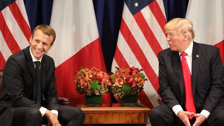 Emmanuel Macron et Donald Trump lors de leur rencontre à New York, le 18 septembre 2017. (LUDOVIC MARIN / AFP)
