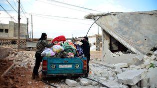 Des habitants de la région d'Alep (Syrie) fuient les combats le 22 février 2016. (HUSEYIN NASIR / ANADOLU AGENCY / AFP)