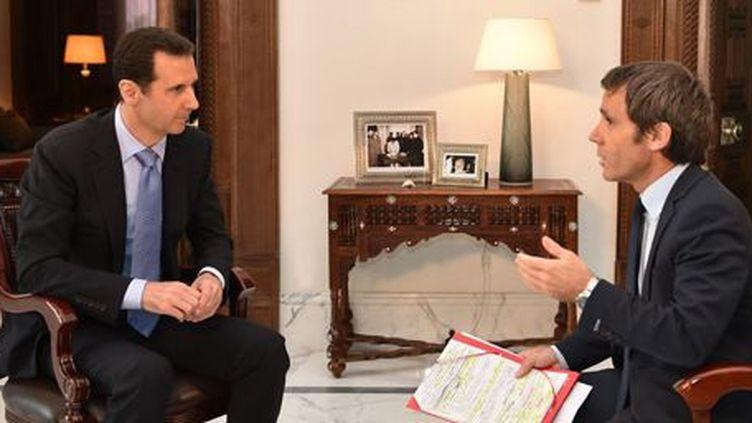 Le président Bachar al-Assad en entretien avec David Pujadas, à Damas le 18 avril 2015. (AFP PHOTO / HO / SANA)