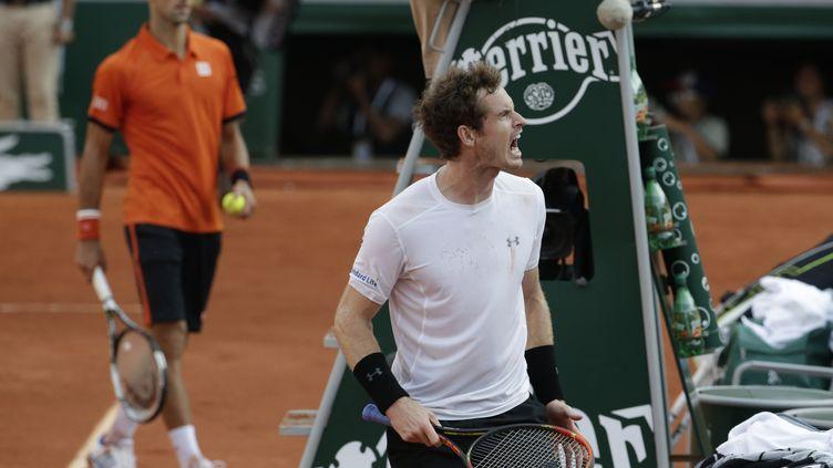 Andy Murray et Novak Djokovic vont devoir patienter une nuit avant de se retrouver (KENZO TRIBOUILLARD / AFP)
