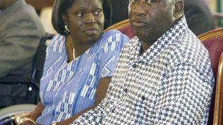 Simoneet Laurent Gbagbo sont photographiés le 27 février 2005 à Bonoua, au sud d'Abidjan (la capitale économique de la Côte d'Ivoire), lors de l'inauguration d'une église méthodiste. (KAMBOU SIA / AFP)