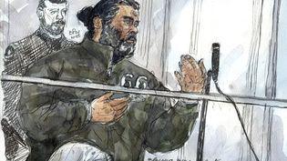 Fahd Jobrani, un Marocain de 36 ans, est poursuivi pour association de malfaiteurs en vue de de la préparation d'actes de terrorisme. Le voici au premier jour de son procès à Paris, le 19 janvier 2015. (BENOIT PEYRUCQ / AFP)
