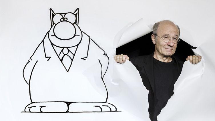 Philippe Geluck et son Chat , en séance photo à Paris (11 septembre 2017)  (Joël Saget / AFP)