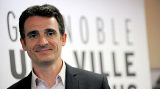 Le candidat écologiste à la mairie de Grenoble (Isère),Eric Piolle, le 24 mars 2014. (JEAN-PIERRE CLATOT / AFP)
