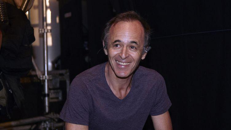 Jean-Jacques Goldman lors d'un concert des Enfoirés àOuveillan, dans l'Aude, le 20 juillet 2014. (GAILLARD NICOLAS / APERCU / SIPA)