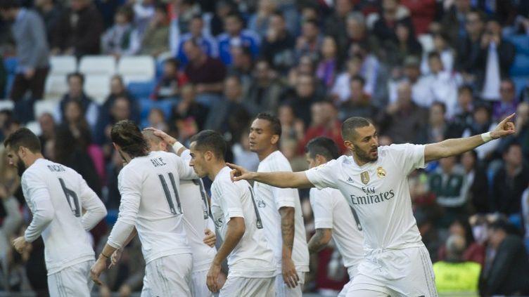 Auteur d'un doublé avec le Real Madrid, Karim Benzema a paru imperturbable... (CURTO DE LA TORRE / AFP)