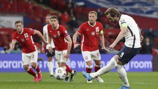 L'attaquant anglais, Harry Kane a ouvert le score sur pénalty face à la Pologne, mercredi 31 mars 2021.  (CATHERINE IVILL / POOL)