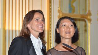 Lors de la passation de pouvoir au ministère de la Cultureentre Aurélie Filippetti et Fleur Pellerin, le 26 août 2014, à Paris. (CITIZENSIDE/SA?D ANAS / AFP)