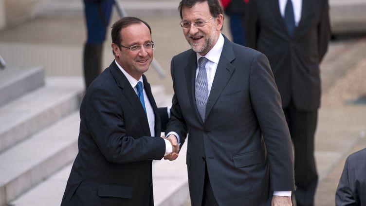 François Hollande (G) et Mariano Rajoy, le 23 mai 2012 au palais de l'Elysée. (FRED DUFOUR / AFP)