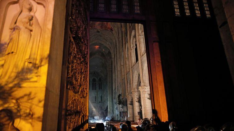 Vue de l'intérieur de Notre-Dame, le 15 avril 2019. (PHILIPPE WOJAZER / POOL / AFP)