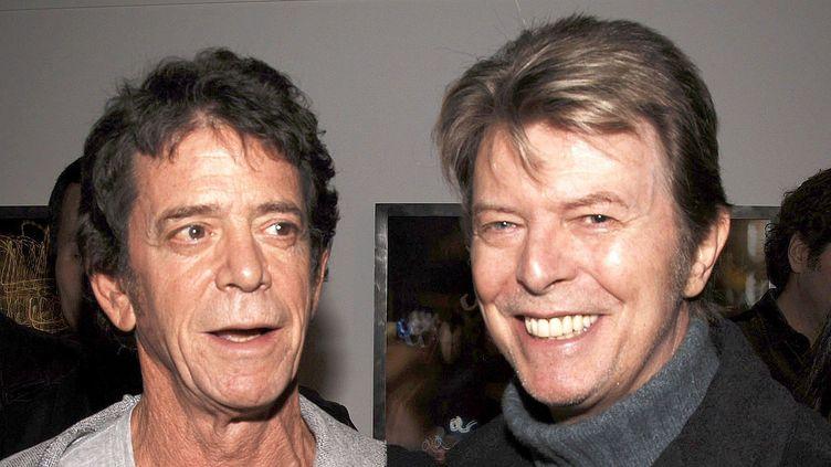 Lou Reed et David Bowie dans une galerie new yorkaise en 2006.  (Andrew H. Walker / Getty Images North America / AFP)