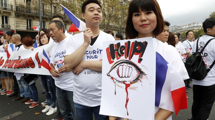 Des manifestants protestent à Paris contre les violences dont la communauté chinoise est la cible, dimanche 4 septembre 2016. (FRANCOIS GUILLOT / AFP)