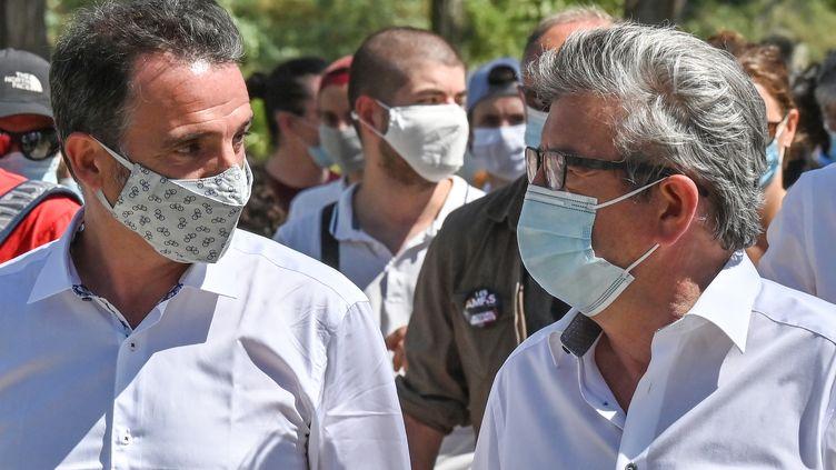 Jean-Luc Mélenchon etÉric Piolle à l'université d'été de La France insoumise à Châteauneuf-sur-Isère, près de Valence (Drôme) le 21 août 2020. (PHILIPPE DESMAZES / AFP)