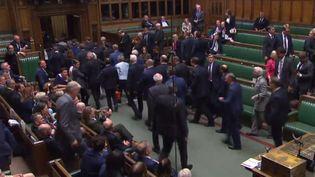 Les députés quittent le Parlement britannique, à Londres, lors de la cérémonie de suspension, le 10 septembre 2019. (HO / AFP)