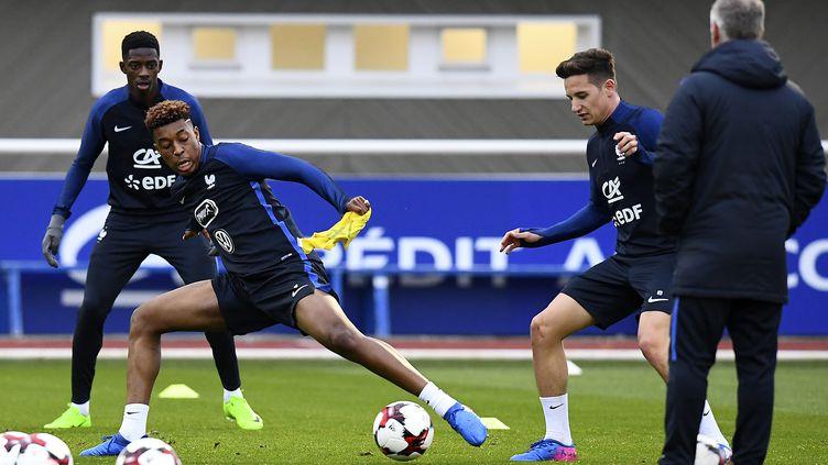 Presnel Kimpembe et Florian Thauvin, lors d'une précédente séance d'entraînement (FRANCK FIFE / AFP)