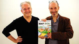 Didier Conrad et Jean-Yves Ferri à Francfort (Allemagne) le 11 Octobre 2013. (DANIEL REINHARDT / DPA)