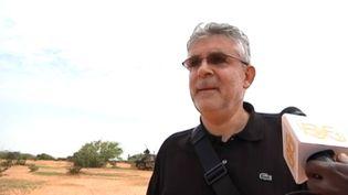 Un témoin sur le site du crash du vol d'Air Algérie, au Mali, le 26 juillet 2014.