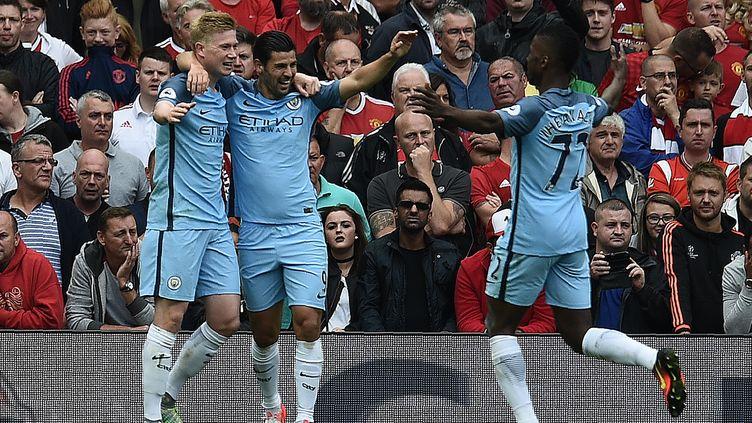 La joie des joueurs de Manchester City après le but de Kevin de Bruyne (OLI SCARFF / AFP)