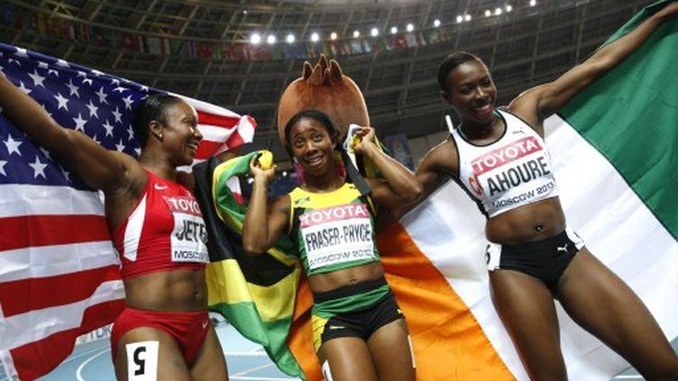 La joie de Murielle Ahoure, médaille d'argent, après le 100 m (ADRIAN DENNIS / AFP)