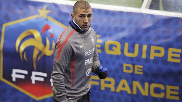Pour Karim Benzema, l'objectif est d'abord de sortir des poules avant de penser à la victoire finale  (FRANCK FIFE / AFP)
