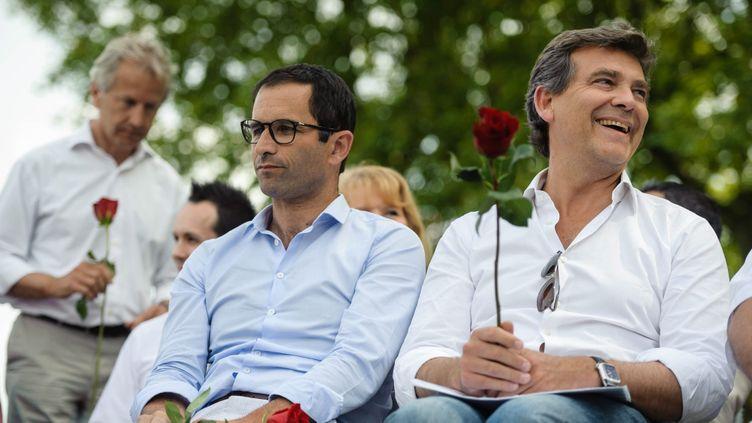 (Arnaud Montebourg et Benoît Hamon lors de la traditionnelle fête de la Rose, le 24 août. © MaxPPP)