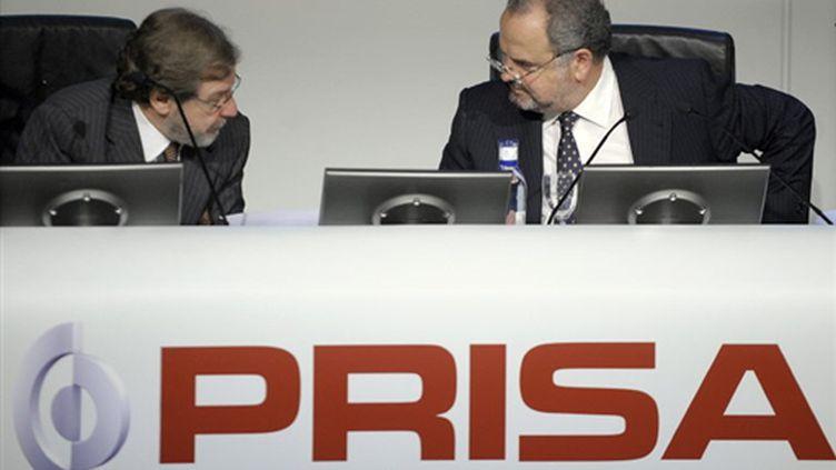 Deux des dirigeants du groupe médiatique privé espagnol Prisa (AFP PHOTO - PHILIPPE DESMAZES)