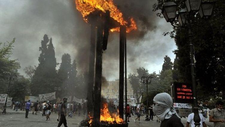 Manifestation violente à Athènes le 29 juin après un vote au Parlement (AFP/LOUISA GOULIAMAKI)