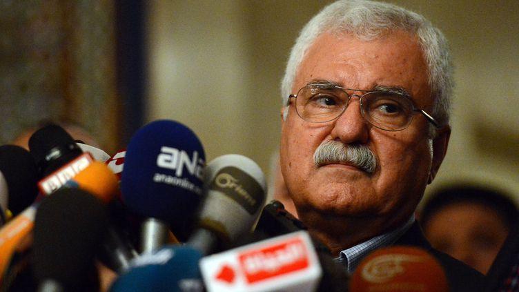 George Sabra, président par intérim du Conseil national syrien,principale composante de la Coalition qui regroupe la majorité des opposants à Bachar Al-Assad, au siège de la Ligue arabe, au Caire (Egypte), le 24 février 2013. (KHALED DESOUKI / AFP)