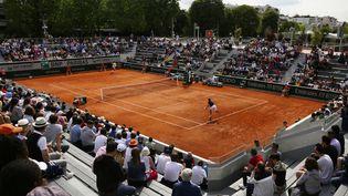 Un match des qualifications de Roland-Garros entre le Français Manuel Guinard et le BelgeKimmer Coppejans, le 22 mai 2019. (IBRAHIM EZZAT / NURPHOTO)