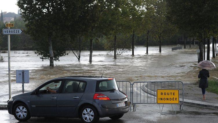Une route inondée dans le Gard, vendredi 10 octobre. (SYLVAIN THOMAS / AFP)