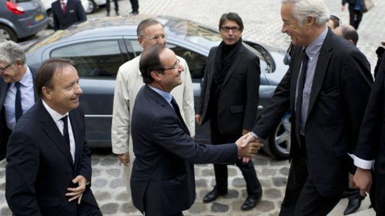 François Rebsamen accueillant François Hollande au Sénat (oct. 2011) (AFP)