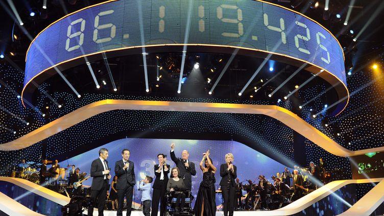 86 119 425 euros euros ont été récoltés pour l'édition 2011 du Téléthon qui s'est achevée dans la nuit de samedi à dimanche 4 décembre. (GONZALO FUENTES / REUTERS)