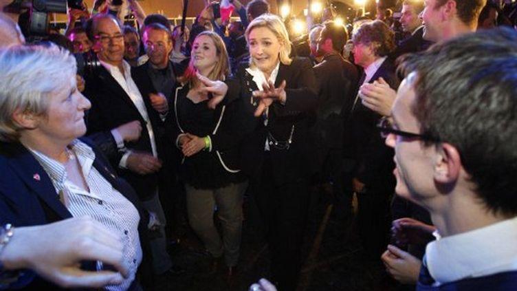 Ambiance de fête au QG électoral de Marine Le Pen, dimanche 22 avril. (FRANCOIS GUILLOT / AFP)