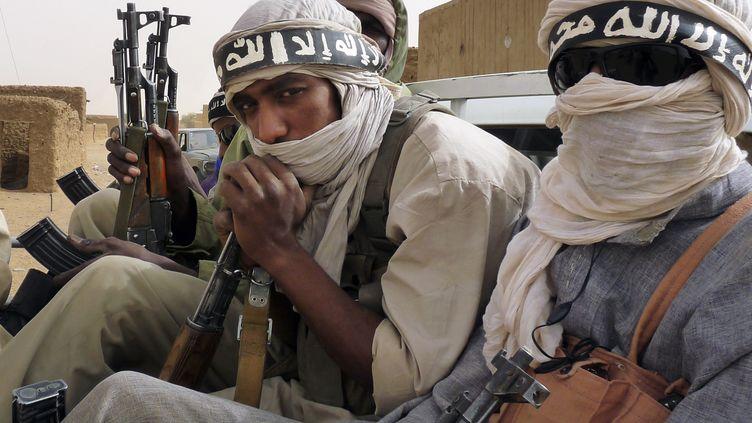 Des miliciens du groupe islamiste Ansar Dine le 16 juin 2012 à Kidal, dans le nord du Mali. Leur chef voulait imposer la charia sur l'ensemble du territoire malien et au-delà. (ADAMA DIARRA / X03753)