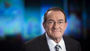 Le présentateur du JT de 13h de TF1, Jean-Pierre Pernaut, dans les locaux de la chaîne à Boulogne-Billancourt (Hauts-de-Seine), le 13 février 2015. (MARTIN BUREAU / AFP)