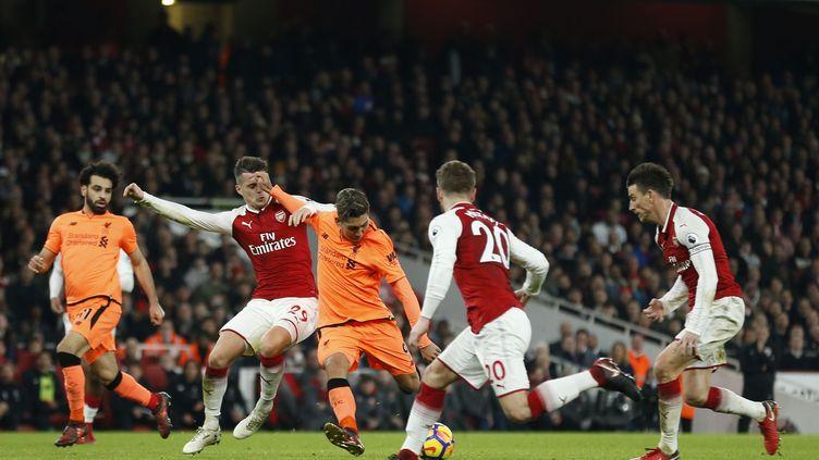 Roberto Firmino a marqué le but du 3-3 pour Liverpool (IAN KINGTON / AFP)